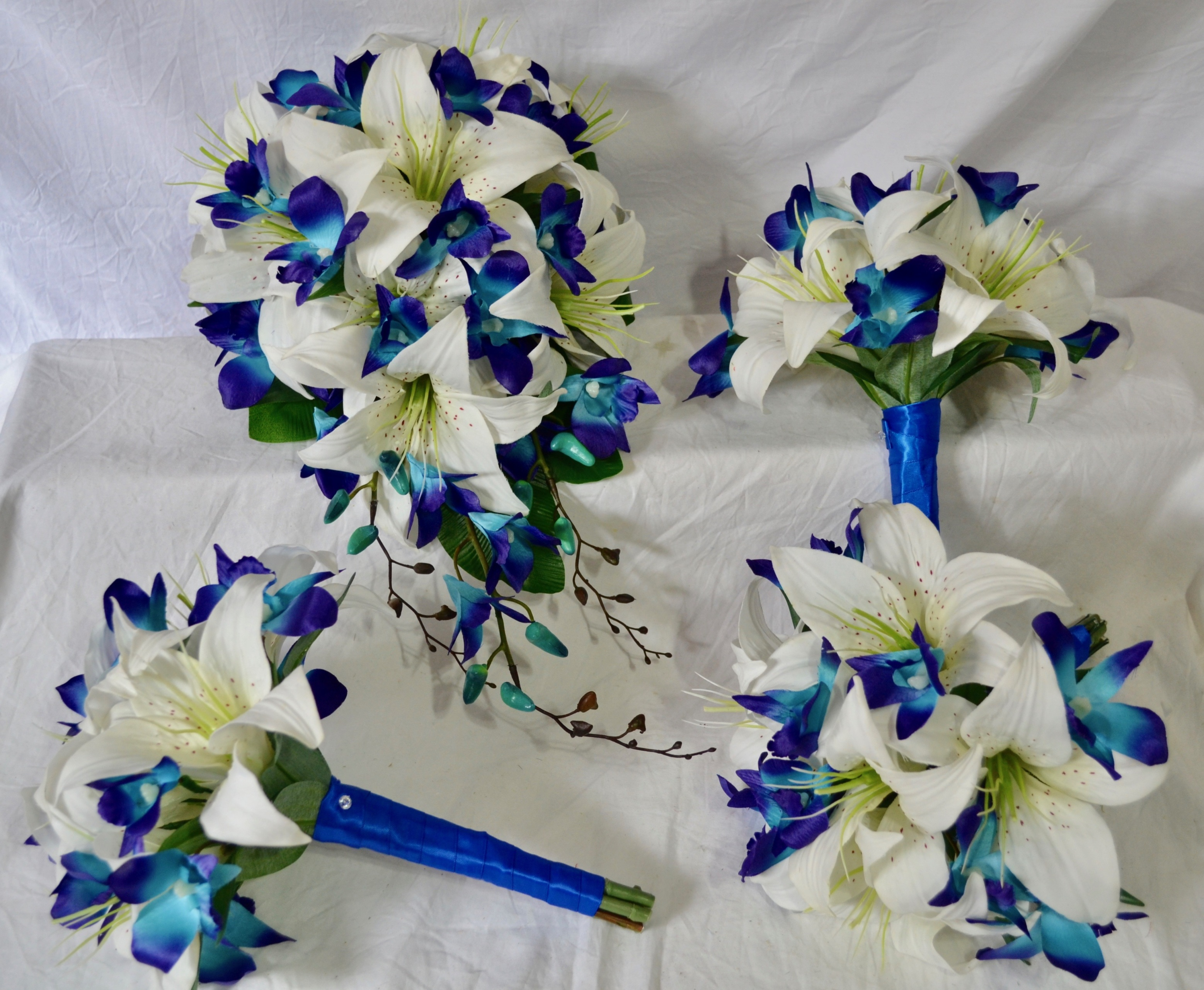 silk wedding bouquets for sale pre made set of white lilies and blue galaxy orchids 7420